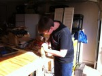 Shannon's son cutting some plywood for the first time.