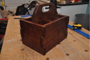 Side view of a Greene and Greene inspired drink carrier