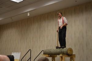 Roy Underhill on a log